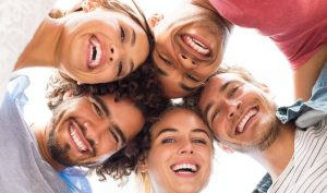 People in the picture illustrate a healthy smile by the way they are smiling.